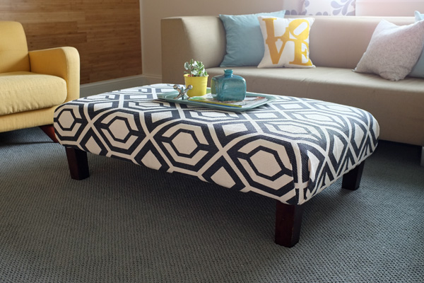 How to Update an Old Ottoman with a $50 Rug | tealandlime.com