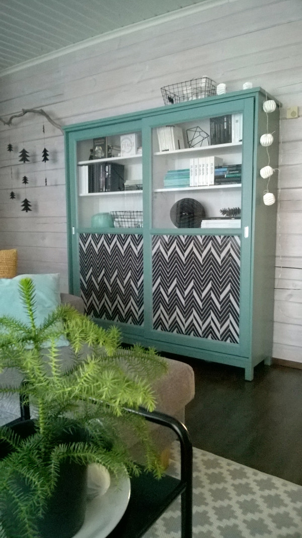 Genius - line the bottom of glass bookcase doors with fabric.