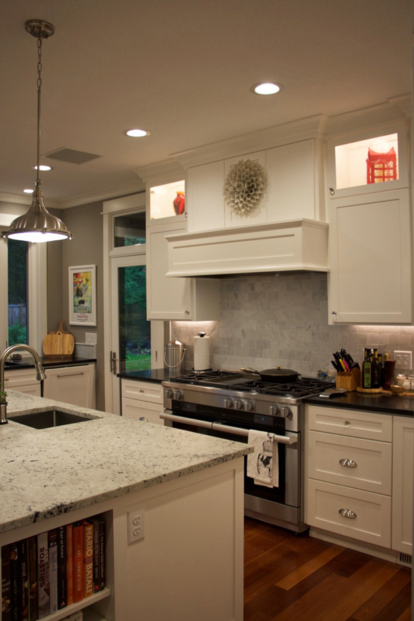 Gorgeous white kitchen remodel with lots of extra special details. Click through to see the amazing before and after.