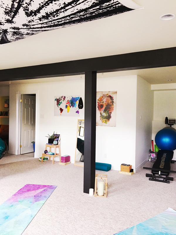 Dayle's Yoga Celler basement makeover before and after from School of Decorating - Love that black support beam !