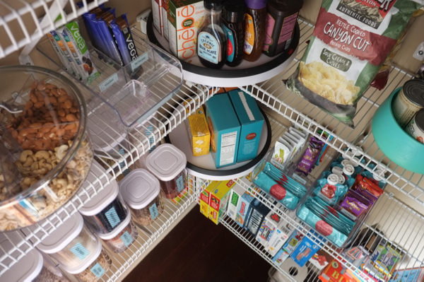 This is a realistic pantry makeover. Even if you can't add pretty wallpaper and change out your wire shelves, you can create a neat and organized pantry that will make you happy every time you open the door.