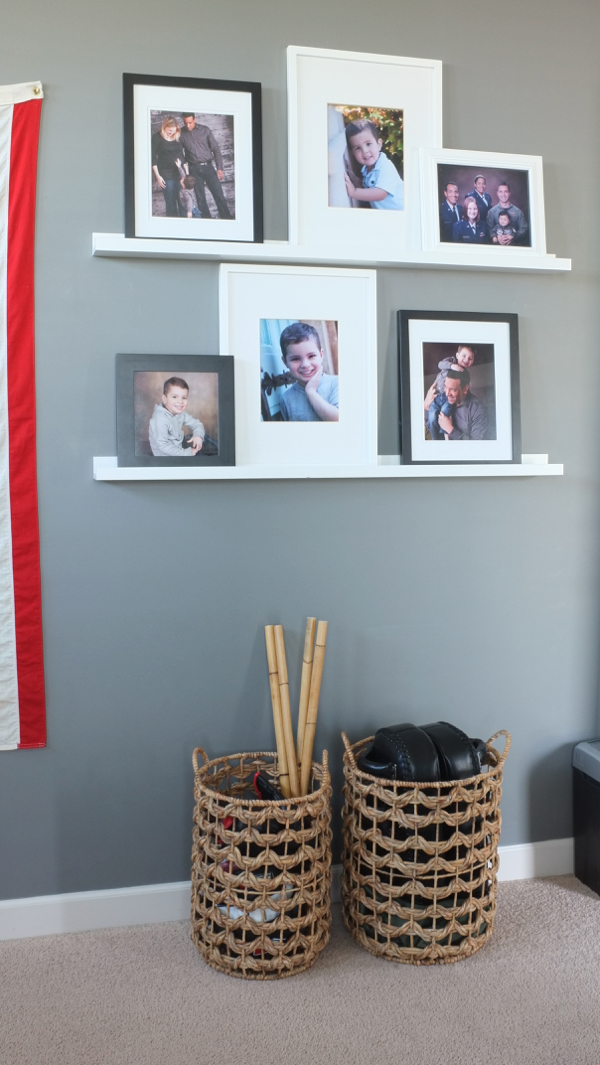 This is a great option for displaying multiple photos - love the mix of black and white frames on white picture ledges.