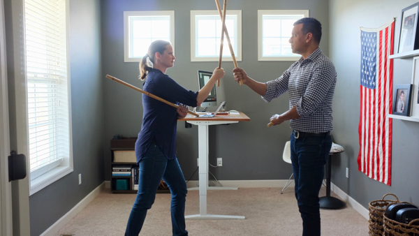 She left half of her home office empty on purpose...so there is room for impromptu workout sessions or martial arts practice with her husband.