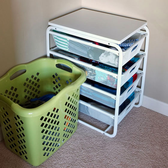 boys closet organization - keep the hamper right next to drawers so when they change the dirty clothes has a greater chance of landing in the hamper