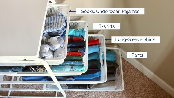 organizing folded clothes for kids in wire drawers - easy for the to access and keep neat