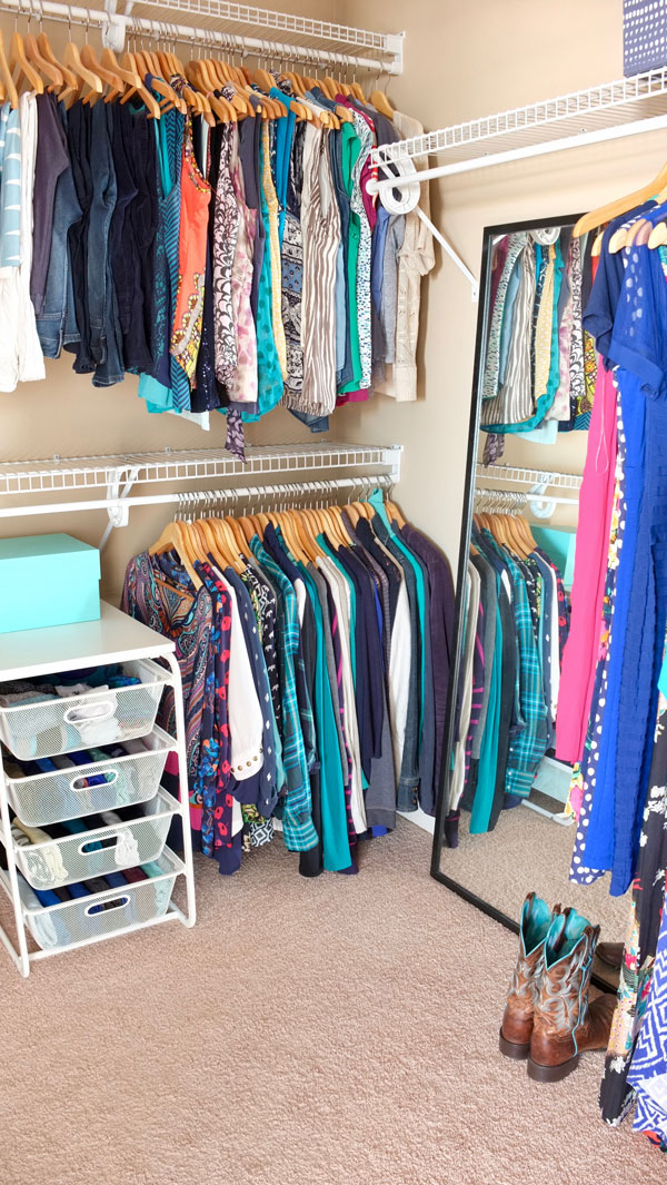 Organized walk-in closet—it looks so nice even though it has inexpensive wire shelves and mesh drawers, which are great for folded clothes
