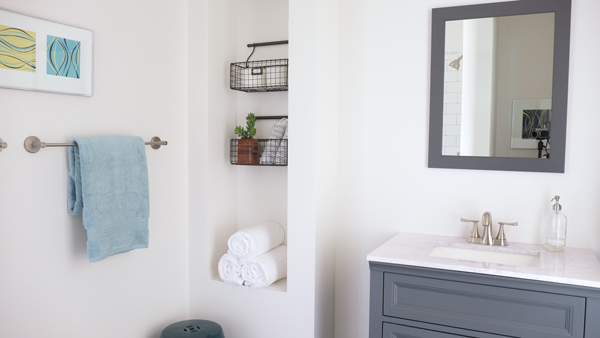 Amazing modern DIY bathroom for under $1500—new tile shower, toilet, and vanity!