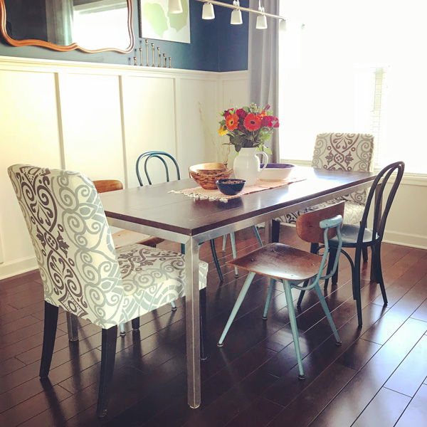 Fun! Mismatched chairs in a formal dining room