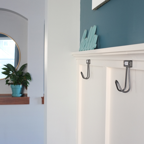 Add wall hooks to create an instant mudroom