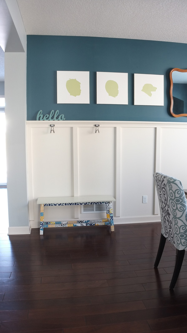 A few feet of wall space, a bench, and a few wall hooks is all you need for a mudroom