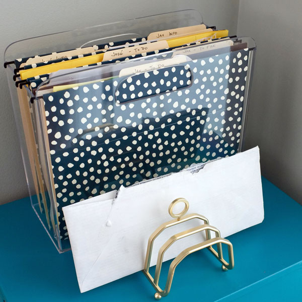 Keep paper piles under control - organize them in a small upright file holder