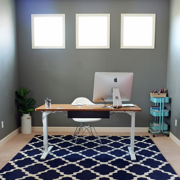 A floating office desk with cord hidden under rug