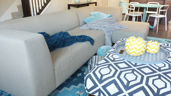 Messy living room throw pillows and blankets