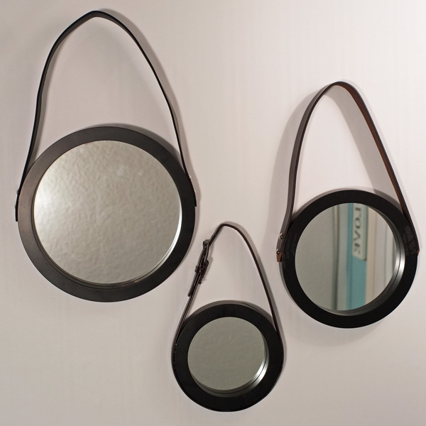 round mirror with leather hanging strap