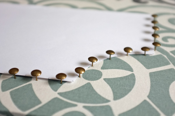 Nailhead trim on cork board