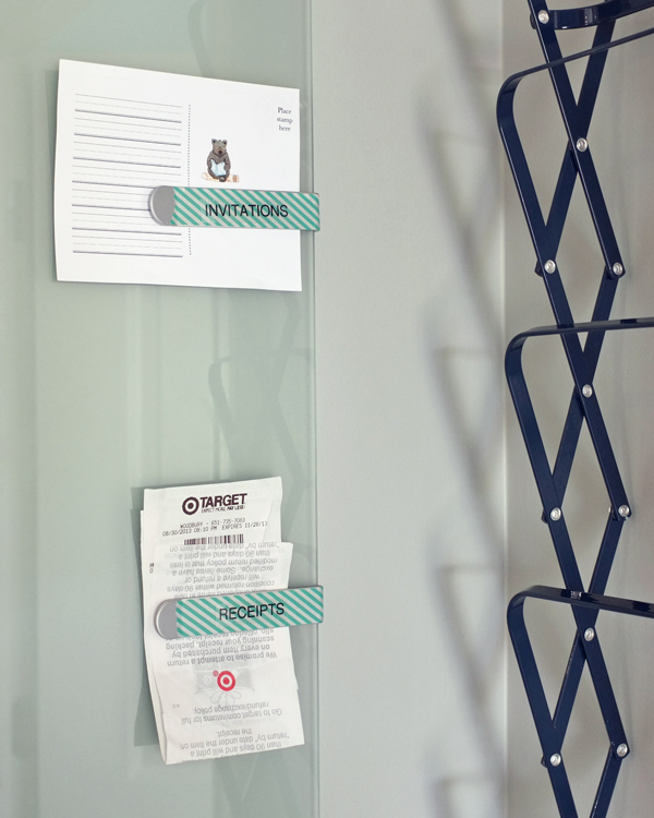 Labeled clips on glass memo board