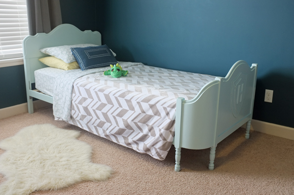 Paint and bedding make this old twin bed fit for a little prince