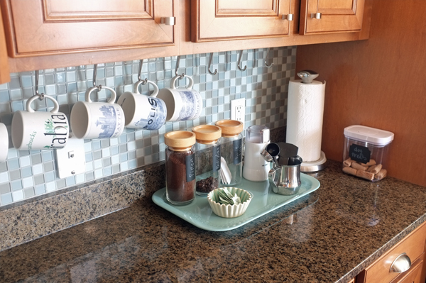 Use a pretty tray to create a coffee bar right on the kitchen counter.