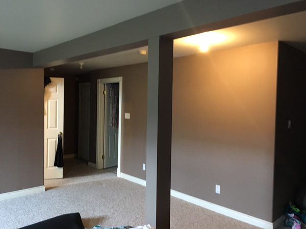 Basement before yoga space makeover