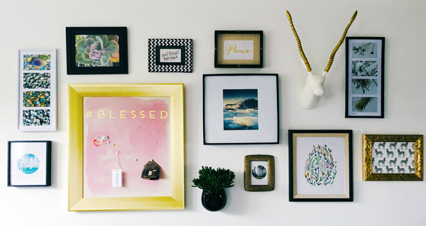 Gorgeous gallery wall for a relaxing yoga space at home.