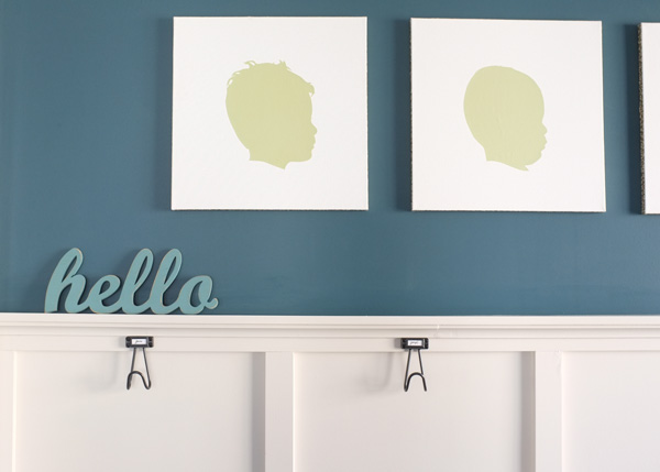 Create an instant mudroom with wall hooks and a bench