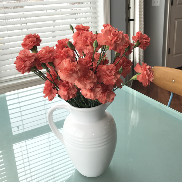 Mini carnations are one of the best budget flowers and they last a long time.