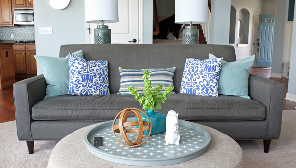 Use faux flowers or greenery on an ottoman to keep it kid-safe and pet-safe