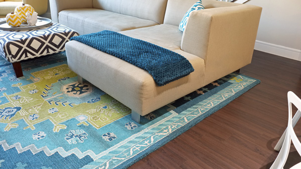 Border of rug under sectional