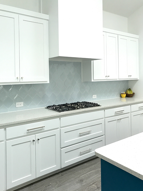 Modern white kitchen with polished nickel cabinet hardware